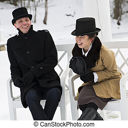 Man and woman laugh over some joke