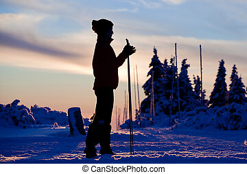 Skier silhouette - Sunset silhouette of cross country skier
