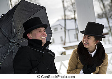 Man and woman laught deeple with closed eyes