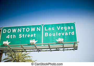 Las Vegas Sign - Las Vegas street sign with palm tree in...