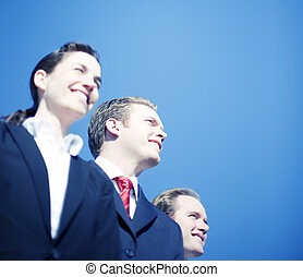 Business Team Vision - Three business people standing...