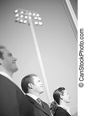Business Vision - three happy business people standing and...