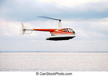 commercial helicopter flying in the sky
