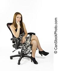 legs crossed - A teenaged girl sitting with her legs crossed