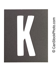 letter k - Gray cardboard with cut out letter K