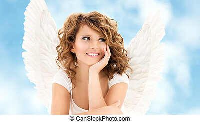 angel girl - picture of happy teenage angel girl over white