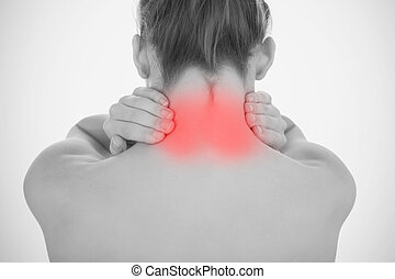 Woman touching highlighted neck pain in black and white