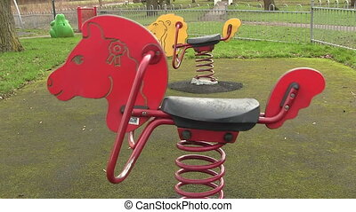 Childs sit on ride in a play ground shot on a winter day