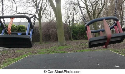 Childs swing in a play ground.