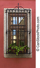 Old window on red wall  under sulight