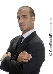 handsome businessman posing with arms crossed and looking to...
