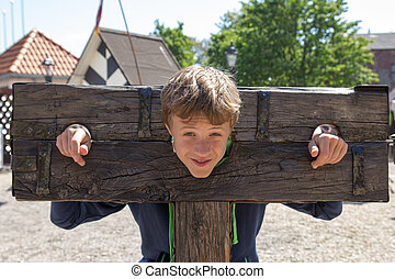 medieval torture device - a boy trapped in a medieval...
