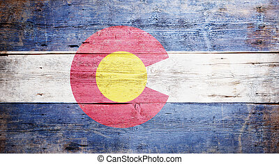 Flag of the state of Colorado painted on grungy wooden...