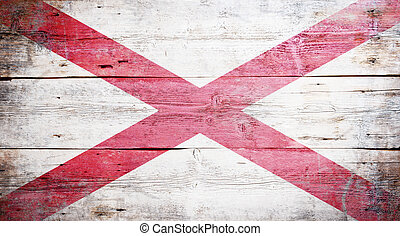 Flag of Alabama painted on grungy wooden background
