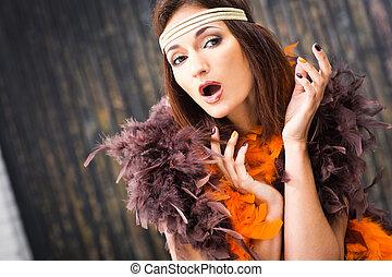 singing actress in brown and orange boa - beautiful actress...