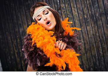 singing actress in brown and orange boa - beautiful actress...