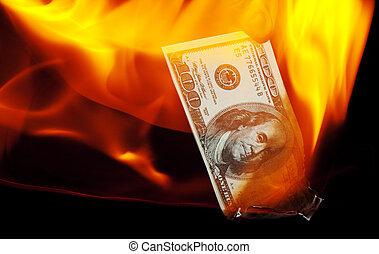 Burning Hundred Dollar Bill - A hundred dollar bill on fire.