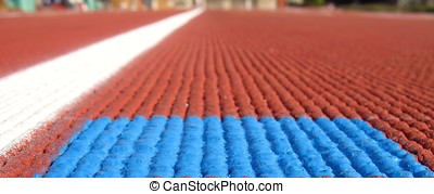 Running Track Macro - -- extreme closeup of a rubberized...