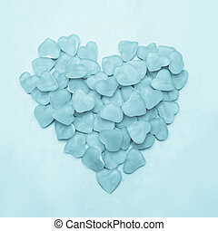 Heart made of candy - Blue heart made of candy on blue...
