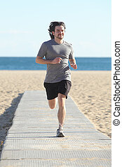 Man running on a runway in the beach