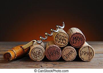 Dated Wine Corks and Corkscrew - Closeup of a group of wine...