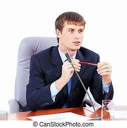 Businessman at meeting - Image of young businessman sitting...
