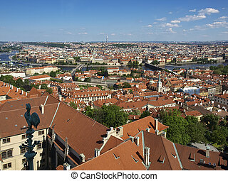 Panorama of Prague from the bell tower of the Cathedral of St. Vitus in the direction of Old Town. Tiled roofs, the river and bridges.