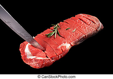 bovine meat on a black background