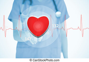Nurse in scrubs touching red ECG line with heart graphic on...