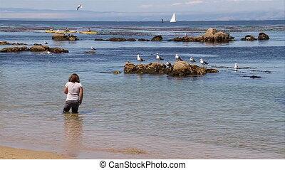 girl stands in ocean