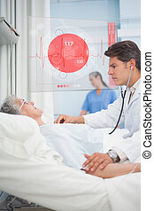 Doctor checking pulse of elderly patient beside hovering...