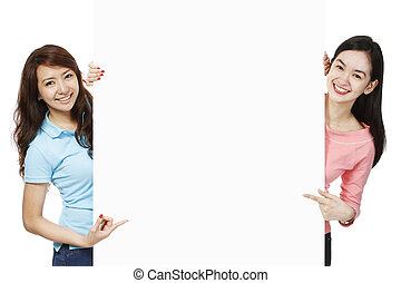 Young Women Advertising - Young women showing or displaying...