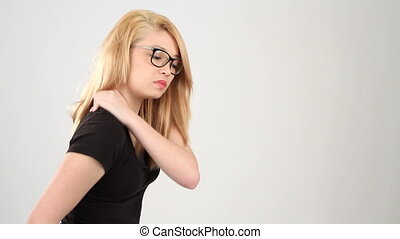 Teenager Shoulder Pain - Teenager massages her shoulder...