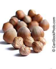 hazelnuts isolated on white background...
