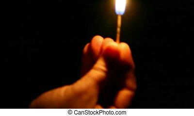 match - A man lights a match