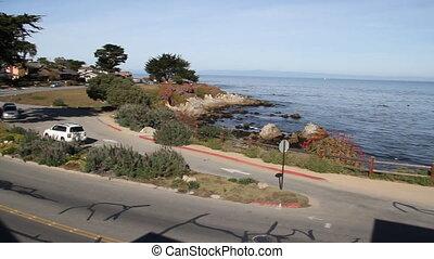 street near rocky shoreline