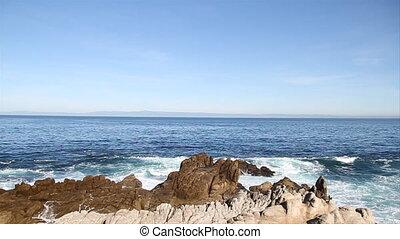 waves break on rocky shore