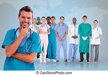 Happy doctor with medical staff behind him on world map...