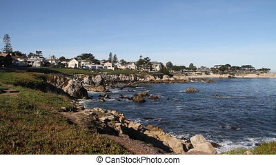 beautiful rocky shoreline with houses