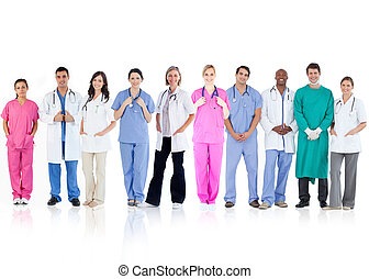 Happy team of doctors standing together in a line on a white...