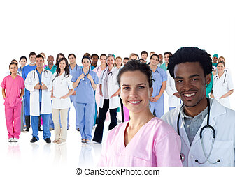 Smiling doctors in front of a team
