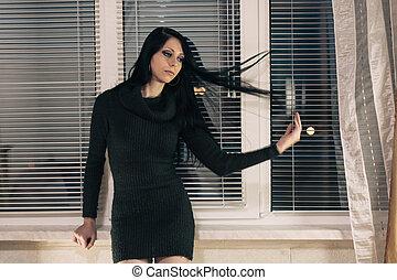 Brunette near window
