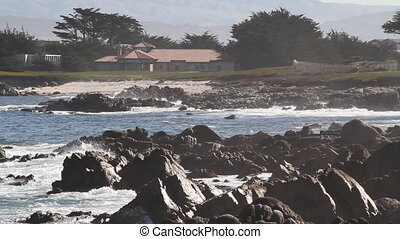rocky shoreline with mist and breaking waves
