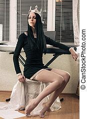 Queen's hobbie - Young attractive brunette wearing crown,...