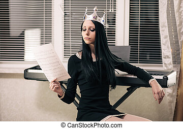Queens hobbie - Young attractive brunette wearing crown,...