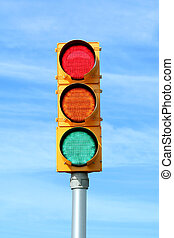 Traffic signal light against blue sky