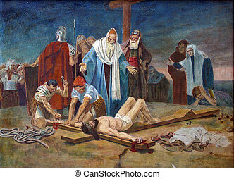 11th Station of the Cross - Crucifixion: Jesus is nailed to...