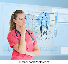 Nurse looking at a futuristic interface about medicine