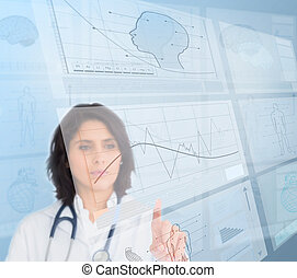 Woman doctor using futuristic interfaces - Serious woman...