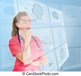 Nurse using futuristic interfaces - Thoughtful nurse using...